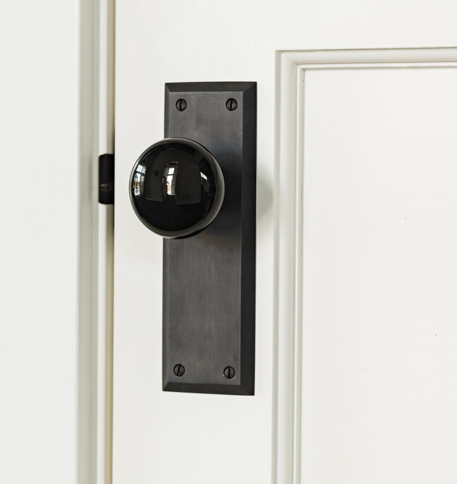 Putman Black Porcelain Knob Interior Door Set   Rejuvenation